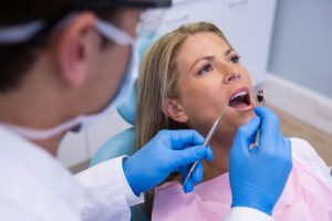 dentist examining woman mouth