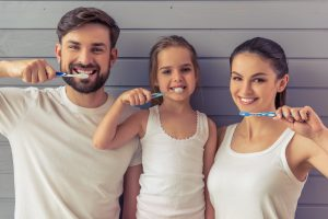family with toothbrush
