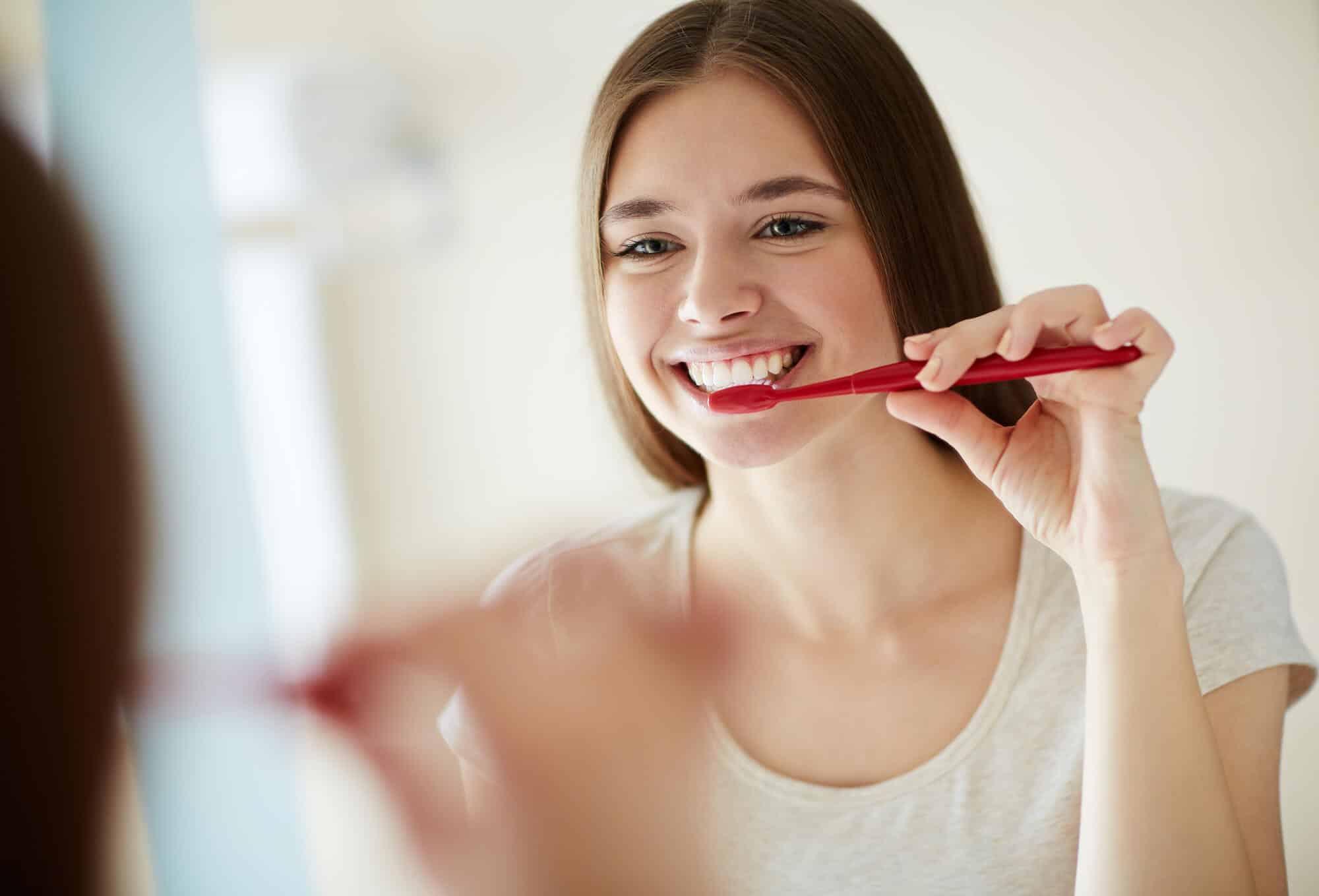 woman brushing Best Dentist Oak Park